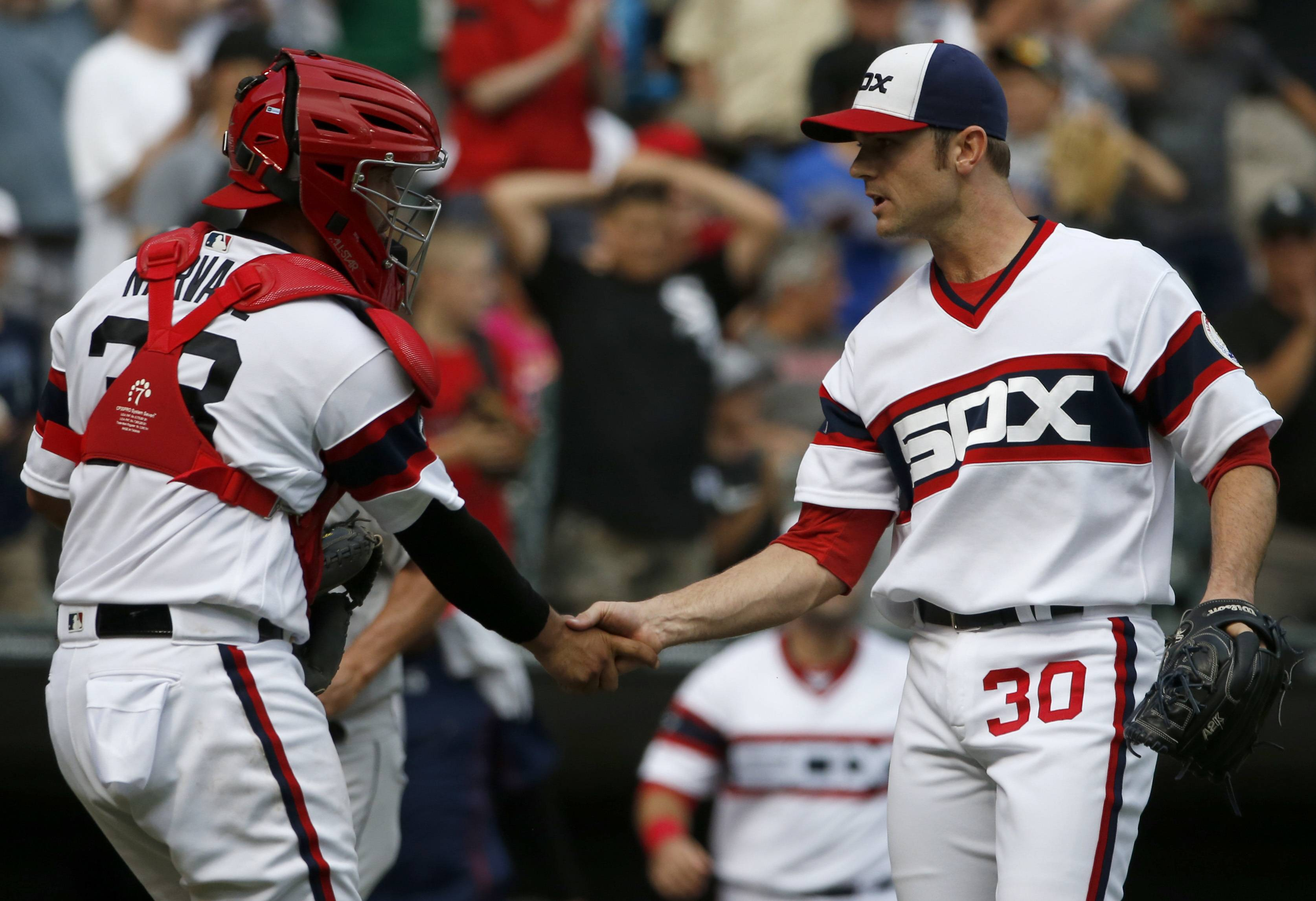 Chicago White Sox closer David Robertson, right, celebrates with catcher Omar Narvaez after they defeated the Seattle Mariners in a baseball game in Chicago, Sunday, Aug. 28, 2016. (AP Photo/Nam Y. Huh)