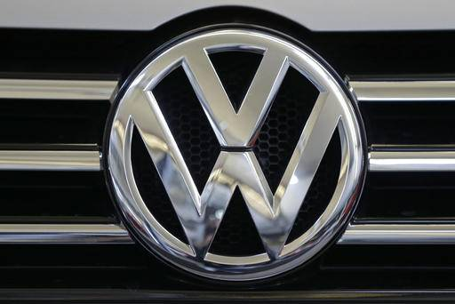 FILE - This Feb. 14, 2013, file photo, shows the Volkswagen logo on the grill of a Volkswagen on display in Pittsburgh. About 210,000 owners of Volkswagens with 2-liter diesel engines that cheat on emissions tests have registered to settle with the company under the terms of a June 2016 court agreement. (AP Photo/Gene J. Puskar, File)