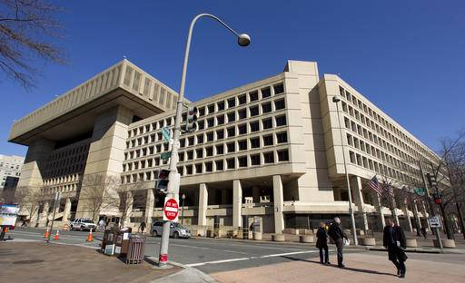 FILE - This Feb. 3, 2012, file photo shows FBI headquarters in Washington. The FBI is warning state officials to boost their election security in light of evidence that hackers breached the election systems of a pair of states. The Aug. 18, 2016, warning came just days after Homeland Security Secretary Jeh Johnson hosted a call with secretaries of state and other state elections officials to talk about cybersecurity and the election infrastructure. (AP Photo/Manuel Balce Ceneta, File)