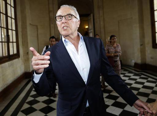 USA's Frank McCourt gestures in the Marseille city hall, Monday, Aug. 29, 2016 in Marseille, southern France. Marseille owner has announced that American businessman Frank McCourt, 63, has bought the popular football team, Olympique de Marseille. (AP Photo/Claude Paris)