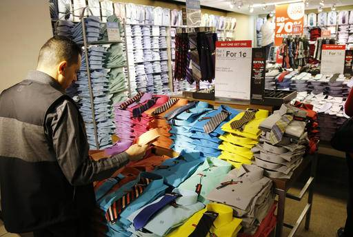 "In this Thursday, March 10, 2016, photo, a man looks at shirts and neckties that are part of a ""Buy One Get One for a Penny"" sale at a J.C. Penney store. On Monday, Aug. 29, the Commerce Department issues its July report on consumer spending, which accounts for roughly 70 percent of U.S. economic activity. (AP Photo/Mark Lennihan)"