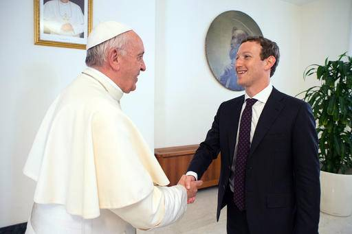 "Pope Francis meets Facebook founder and CEO Mark Zuckerberg, at the Santa Marta residence, the guest house in Vatican City where the pope lives, Monday, Aug. 29, 2016. Vatican spokesman Greg Burke says a topic of discussion at Monday's meeting was ""how to use communication technologies to alleviate poverty, encourage a culture of encounter, and make a message of hope arrive, especially to those most in need.'' (L'Osservatore Romano/Pool Photo via AP)"