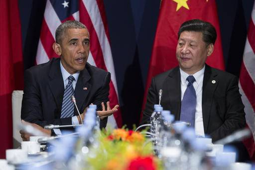 In this photo taken Nov. 30, 2015, President Barack Obama meets with Chinese President Xi Jinping in Le Bourget, France. A trade deal that is a centerpiece of Obama's efforts to counter Chinese influence in Asia hangs in the balance as he makes his last visit to Asia as president. (AP Photo/Evan Vucci)