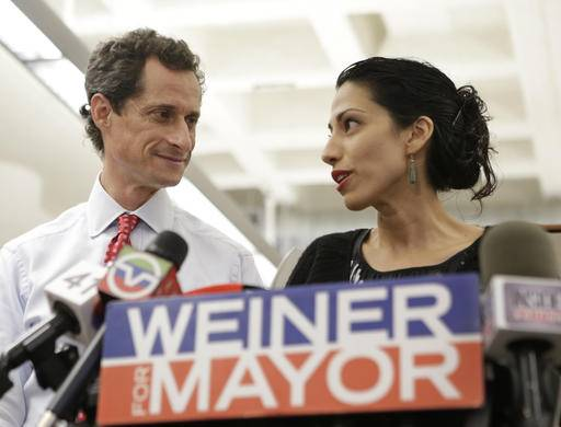 FILE - In this July 23, 2013 file photo, Huma Abedin, alongside her husband, then-New York mayoral candidate Anthony Weiner, speaks during a news conference in New York. Democratic presidential candidate Hillary Clinton aide Huma Abedin says she is separating from husband Anthony Weiner after another sexting revelation involving the former congressman from New York. (AP Photo/Kathy Willens, File)