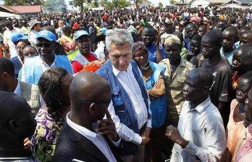 U.N. High Commissioner for Refugees Filippo Grandi, center, visits a transit center for South Sudanese refugees in the remote northwestern district of Adjumani, near the border with South Sudan, in Uganda, Monday, Aug. 29, 2016. Less than two months since a new outbreak of violence in South Sudan sent a surge of about 70,000 refugees into Uganda, the U.N. and its partners are struggling to feed them. (AP Photo/Stephen Wandera)
