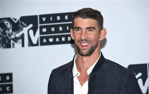 Michael Phelps poses in the press room at the MTV Video Music Awards at Madison Square Garden on Sunday, Aug. 28, 2016, in New York. (Photo by Evan Agostini/Invision/AP)