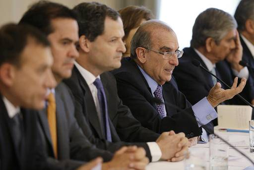 Humberto de la Calle, fourth from left, the chief of Colombia's government negotiation team with rebels of the Revolutionary Armed Forces of Colombia, FARC, speaks during a press conference at the presidential palace in Bogota, Colombia, Monday, Aug. 29, 2016. A permanent cease-fire took effect in Colombia on Monday as a result of a peace accord for ending five decades of war between the government and the rebels group. (AP Photo/Fernando Vergara)