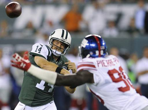 New York Jets quarterback Ryan Fitzpatrick (14) throws a pass over New York Giants defensive end Jason Pierre-Paul (90) during the first half of an NFL preseason football game Saturday, Aug. 27, 2016, in East Rutherford, N.J. (AP Photo/Bill Kostroun)