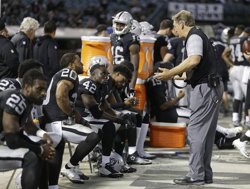 Oakland Raiders head coach Jack Del Rio gestures toward safety Karl Joseph (42) and strong safety Nate Allen (20) sitting on the bench during the second half of an NFL preseason football game against the Tennessee Titans Saturday, Aug. 27, 2016, in Oakland, Calif. Tennessee won the game 27-14. (AP Photo/Ben Margot)