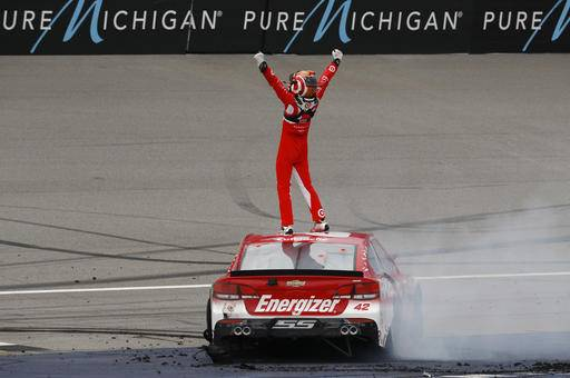 Kyle Larson celebrates winning the NASCAR Sprint Cup Series auto race at Michigan International Speedway, in Brooklyn, Mich., Sunday, Aug. 28, 2016. (AP Photo/Paul Sancya)