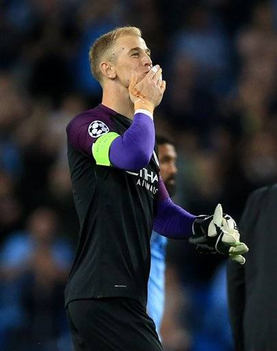 Manchester City goalkeeper Joe Hart salutes the fans after the Champions League Play-off, Second Leg match against Steaua Bucharest at the Etihad Stadium, Manchester, England, Wednesday Aug. 24, 2016. (Nigel French / PA via AP)