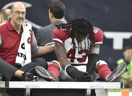 Arizona Cardinals defensive back Mike Jenkins (43) is taken off the field by cart after an injury during the first half of an NFL preseason football game against the Houston Texans, Sunday, Aug. 28, 2016, in Houston. (AP Photo/Jeff Roberson)