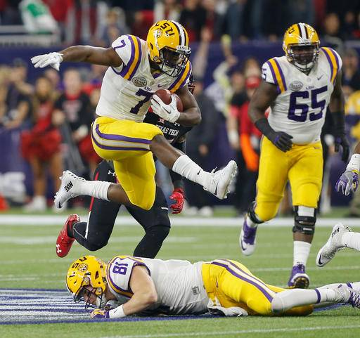 FILE - In this Dec. 29, 2015, file photo, LSU running back Leonard Fournette (7) hurdles tight end Colin Jeter (81) as he rushes against Texas Tech during the first half of the Texas Bowl NCAA college football game in Houston. All eyes are on Fournette as fifth-ranked LSU enters Week 1 of a highly anticipated season. (AP Photo/Bob Levey, File)