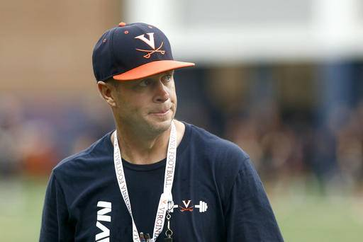 FILE - In this Aug. 6, 2016, file photo, Virginia coach Bronco Mendenhall watches drills during NCAA college football practice in Charlottesville, Va. Virginia heads into its first game week under new coach Bronco Mendenhall with a new quarterback and a healthy respect for it Championship Subdivision opponent, Richmond. (Ryan M. Kelly/The Daily Progress via AP, File)