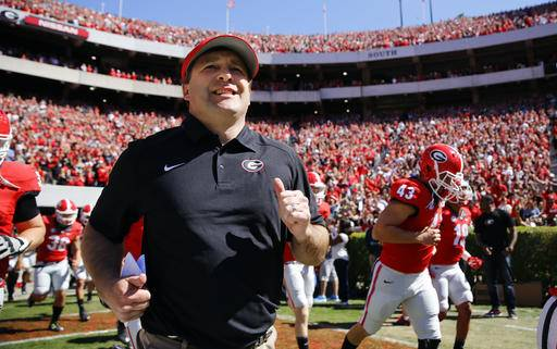 FILE - In this April 16, 2016 file photo, Georgia first-year head coach Kirby Smart runs into a packed Sandford Stadium with his players for the school's spring NCAA college football game in Athens, Ga. No. 18 Georgia begins the Kirby Smart era with a challenging opener against No. 22 North Carolina. (AP Photo/John Bazemore, File)