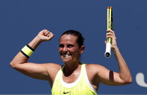 Roberta Vinci, of Italy, reacts after defeating Anna-Lena Friedsam, of Germany, during the first round of the U.S. Open tennis tournament, Monday, Aug. 29, 2016, in New York. (AP Photo/Alex Brandon)
