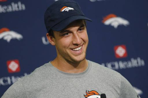 Denver Broncos quarterback Trevor Siemian smiles as he jokes with reporters while fielding questions during a news conference after the team's NFL football practice at the Broncos' headquarters, Monday, Aug. 29, 2016, in Englewood, Colo. (AP Photo/David Zalubowski)