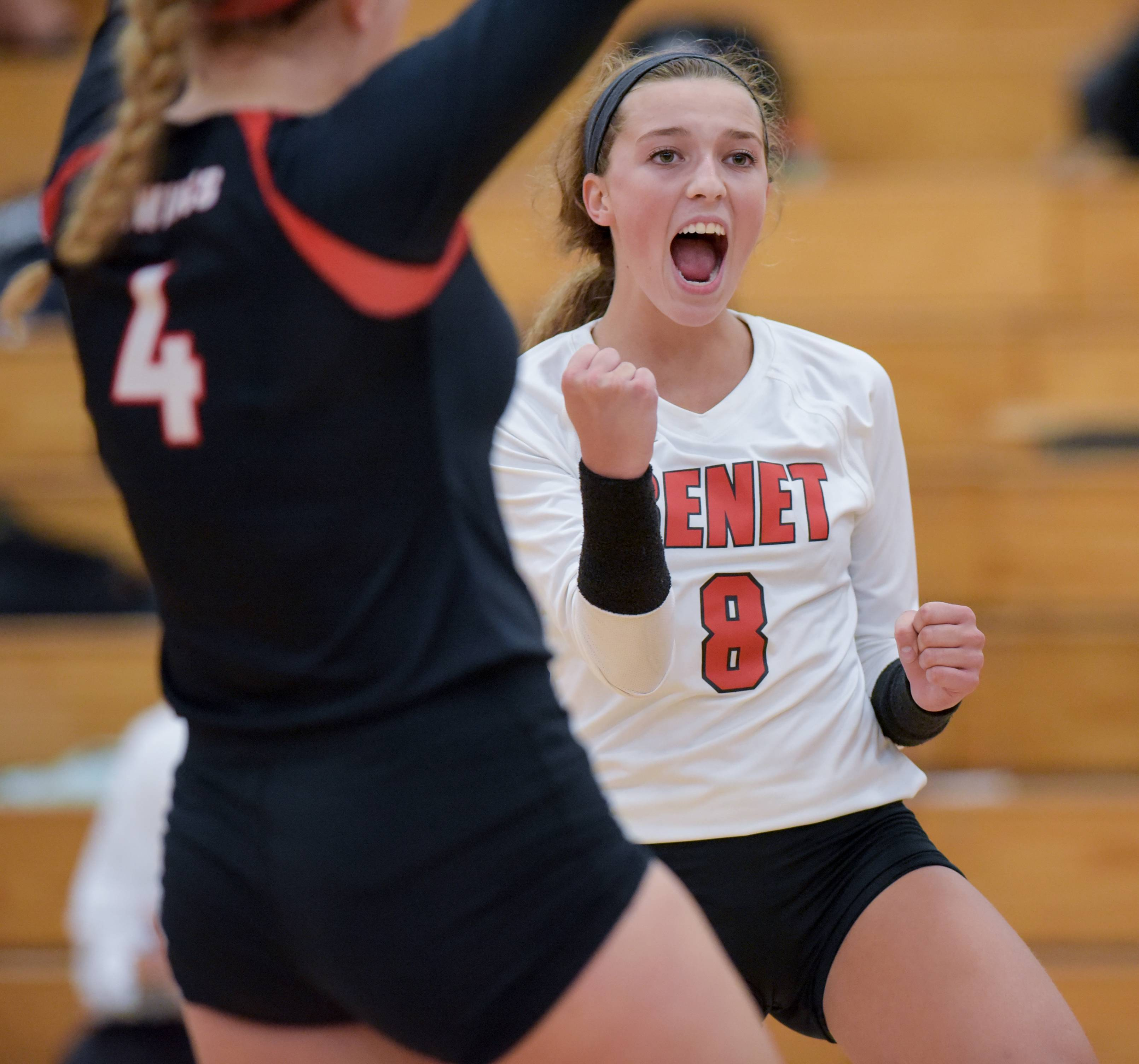 Benet Academy's Hattie Monson and Lauren Barnes celebrate a point during a win over Providence Catholic during girls varsity volleyball at home in Lisle Tuesday.