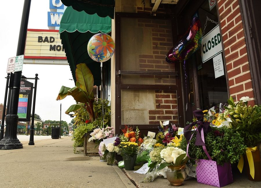 Flowers and other memorials sat outside the Catlow Theater in downtown Barrington on Tuesday in honor of Roberta Rapata, co-owner of the theater and neighboring Boloney's Sandwich Shop.