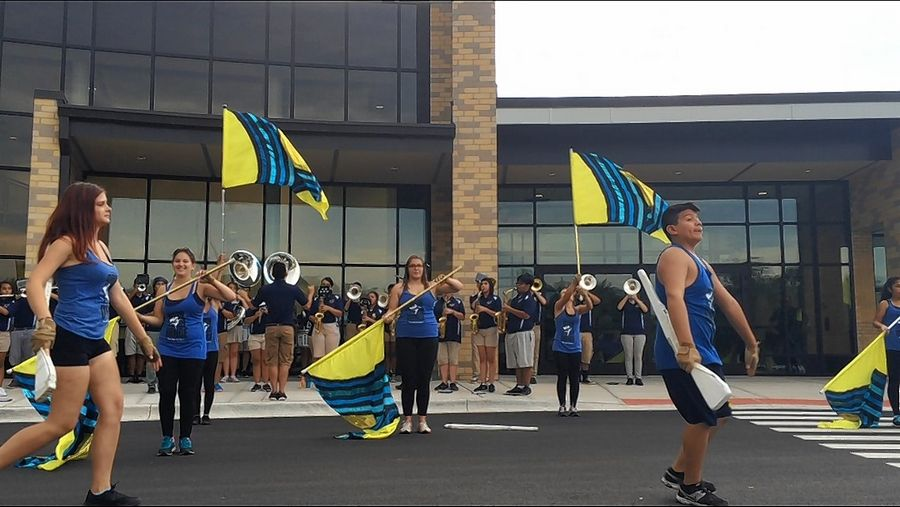 Students entertain outside Round Lake High School before Monday's ceremony touting its renovation and expansion