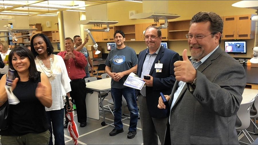 Tours of the expansion at Round Lake High School were given Monday. Round Lake Mayor Daniel MacGillis, far right, was pumped about the new science laboratory.