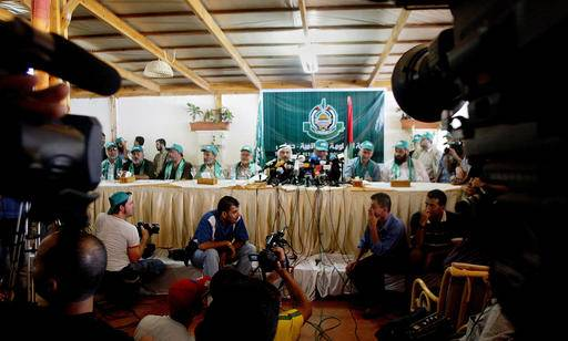 "File - In this Saturday, Aug. 13, 2005 file photo, media covers Hamas press conference in Gaza City. Human Rights Watch on Tuesday said both the Islamic militant group Hamas, which rules Gaza, and the Western-backed Palestinian government led by President Mahmoud Abbas in the West Bank are ???arresting, abusing, and criminally charging journalists and activists who express peaceful criticism of the authorities."" The rival groups have been split since Hamas seized control of Gaza in 2007. Since then, they have periodically launched crackdowns against their rivals to consolidate power. (AP Photo/Hatem Moussa, File)"