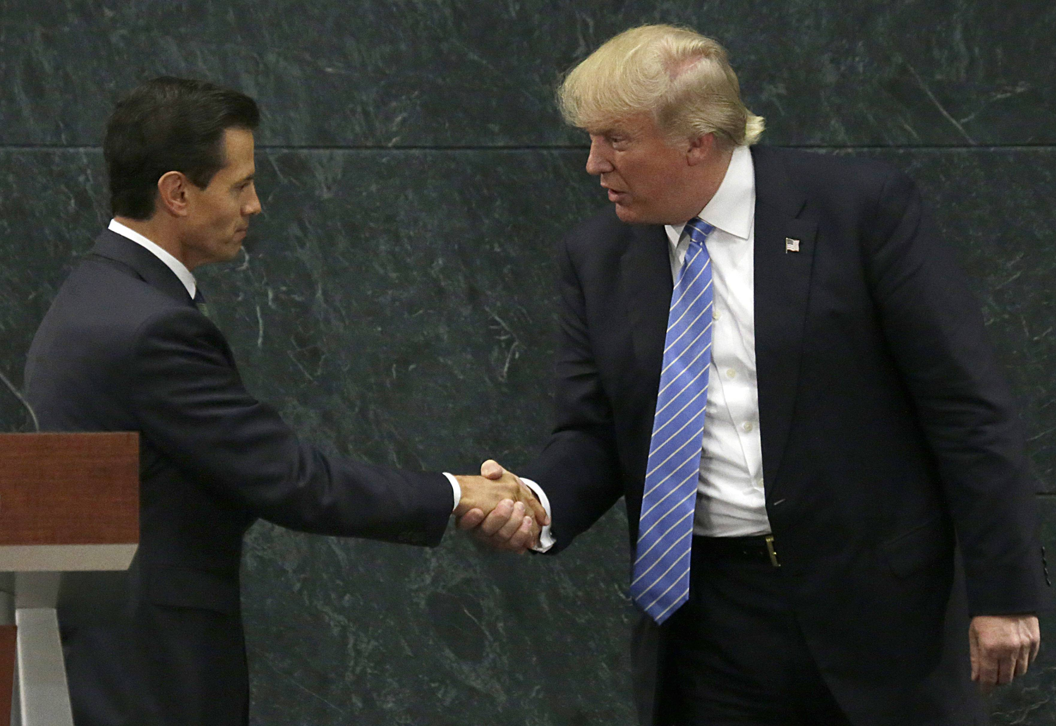 Mexico President Enrique Pena Nieto and Republican presidential nominee Donald Trump shake hands after a joint statement at Los Pinos, the presidential official residence, in Mexico City, Wednesday, Aug. 31, 2016. Trump is calling his surprise visit to Mexico City Wednesday a 'great honor.' The Republican presidential nominee said after meeting with Pena Nieto that the pair had a substantive, direct and constructive exchange of ideas.v(AP Photo/Marco Ugarte)