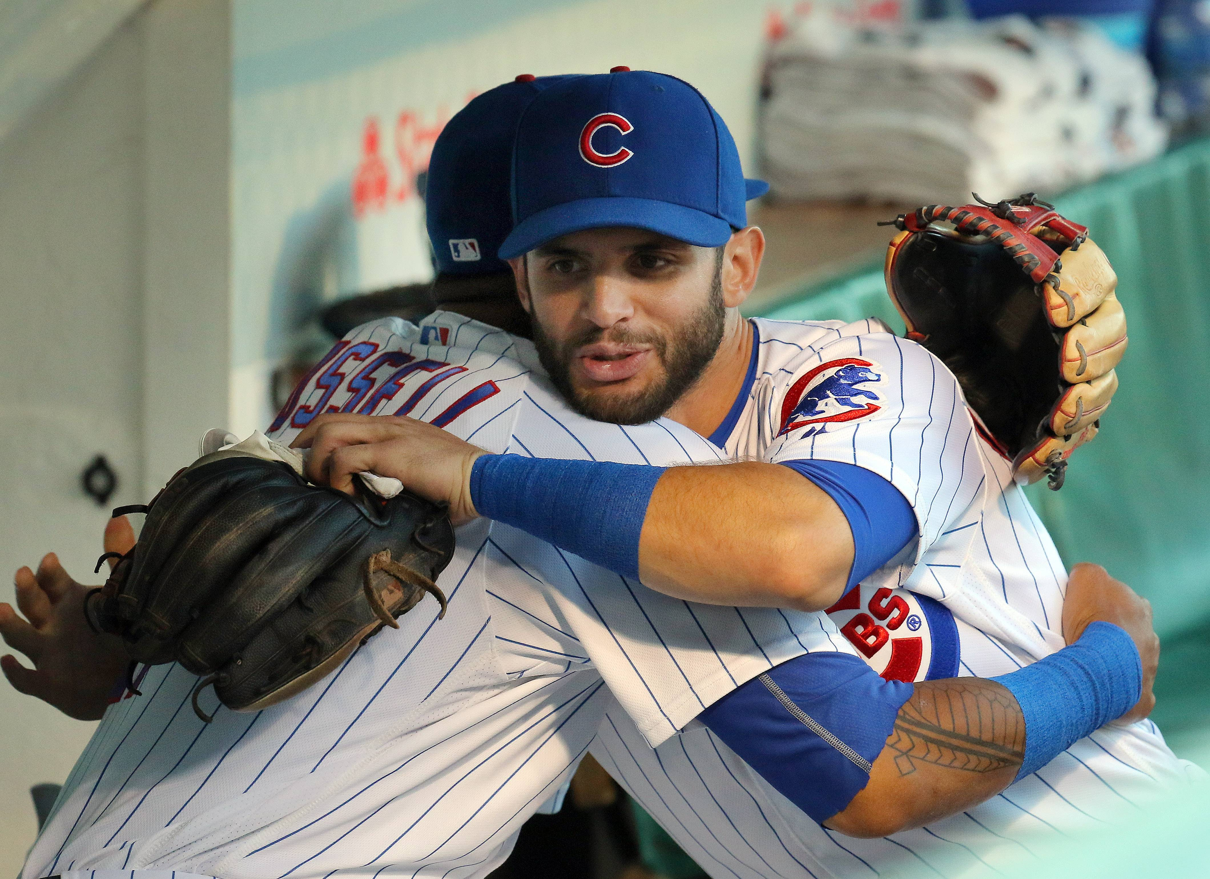 Steve Lundy/slundy@dailyherald.comChicago Cubs second baseman Tommy La Stella hugs Chicago Cubs shortstop Addison Russell on the bench during their game against the Pittsburg Pirates at Wrigley Field in Chicago Wednesday, August 31, 2016.