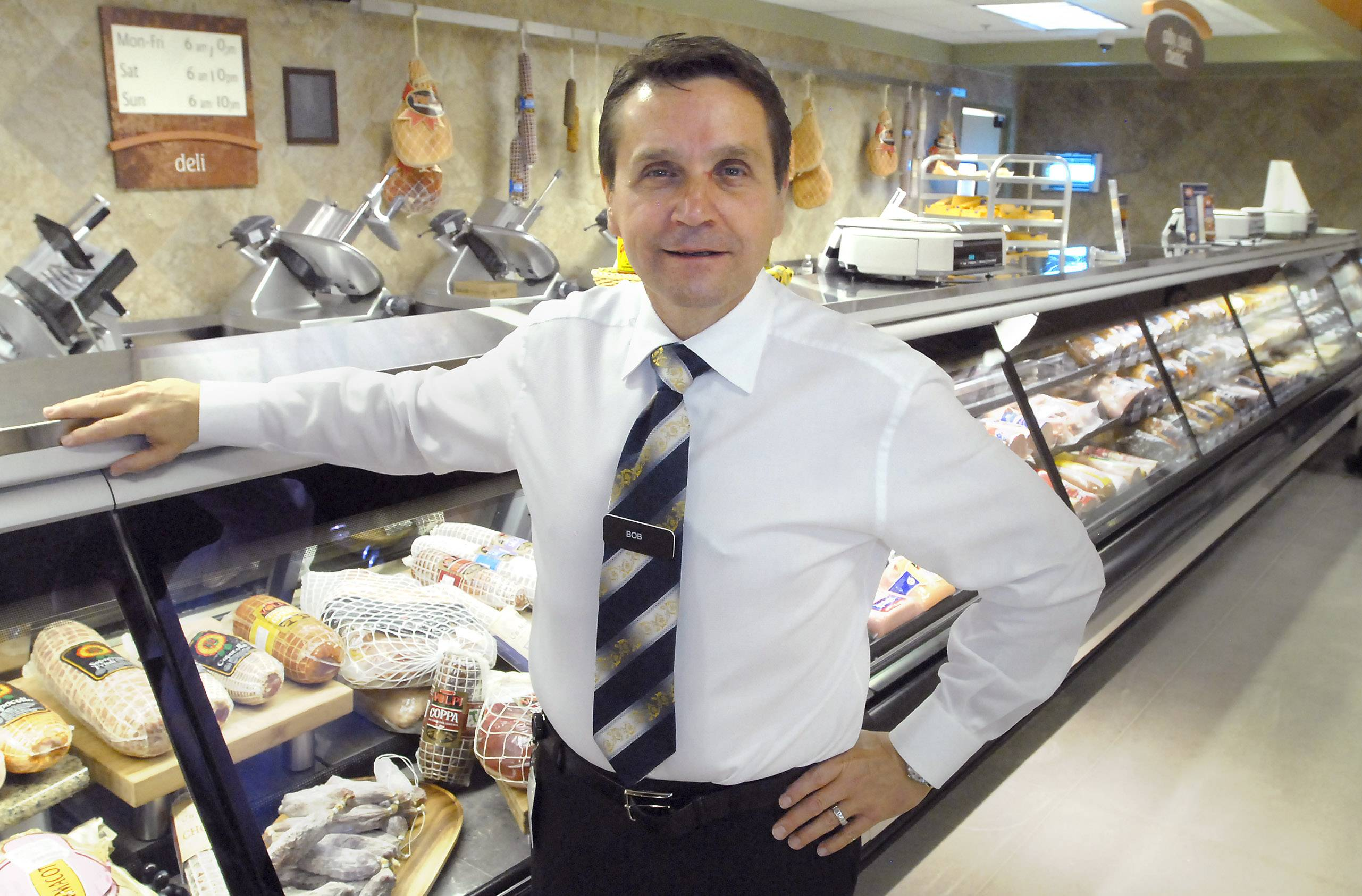 Bob Mariano, owner of Mariano's Fresh Market, stands at the deli counter when he opened the Arlington Heights store in July 2010. He is retiring today.