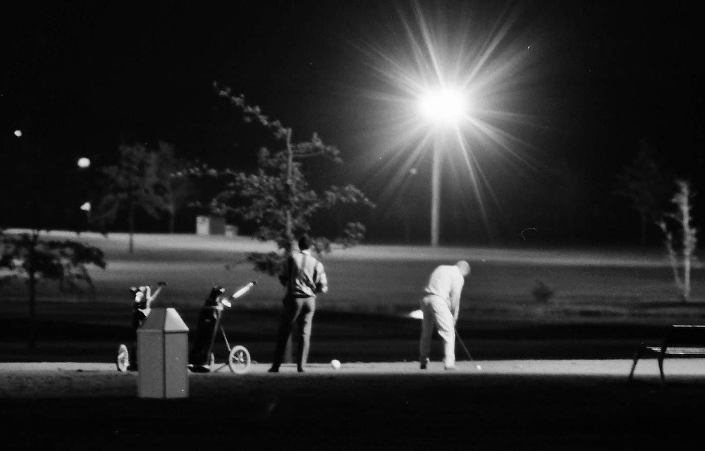 A couple of golfers trying their luck at night golf at Arlington Park in September of 1965.