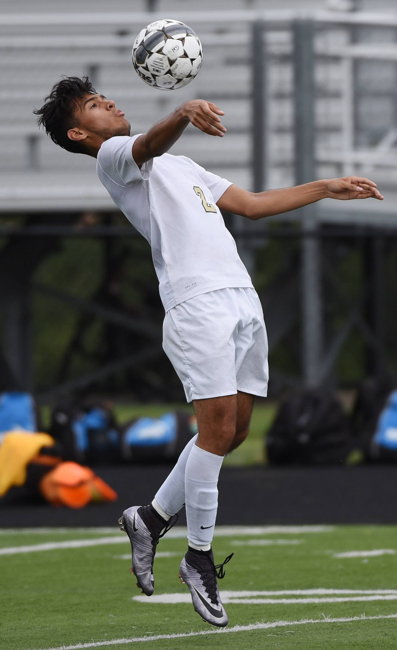 Grayslake North's Cristian Guerrero keeps the ball in front of himself during Saturday's soccer game against Warren.