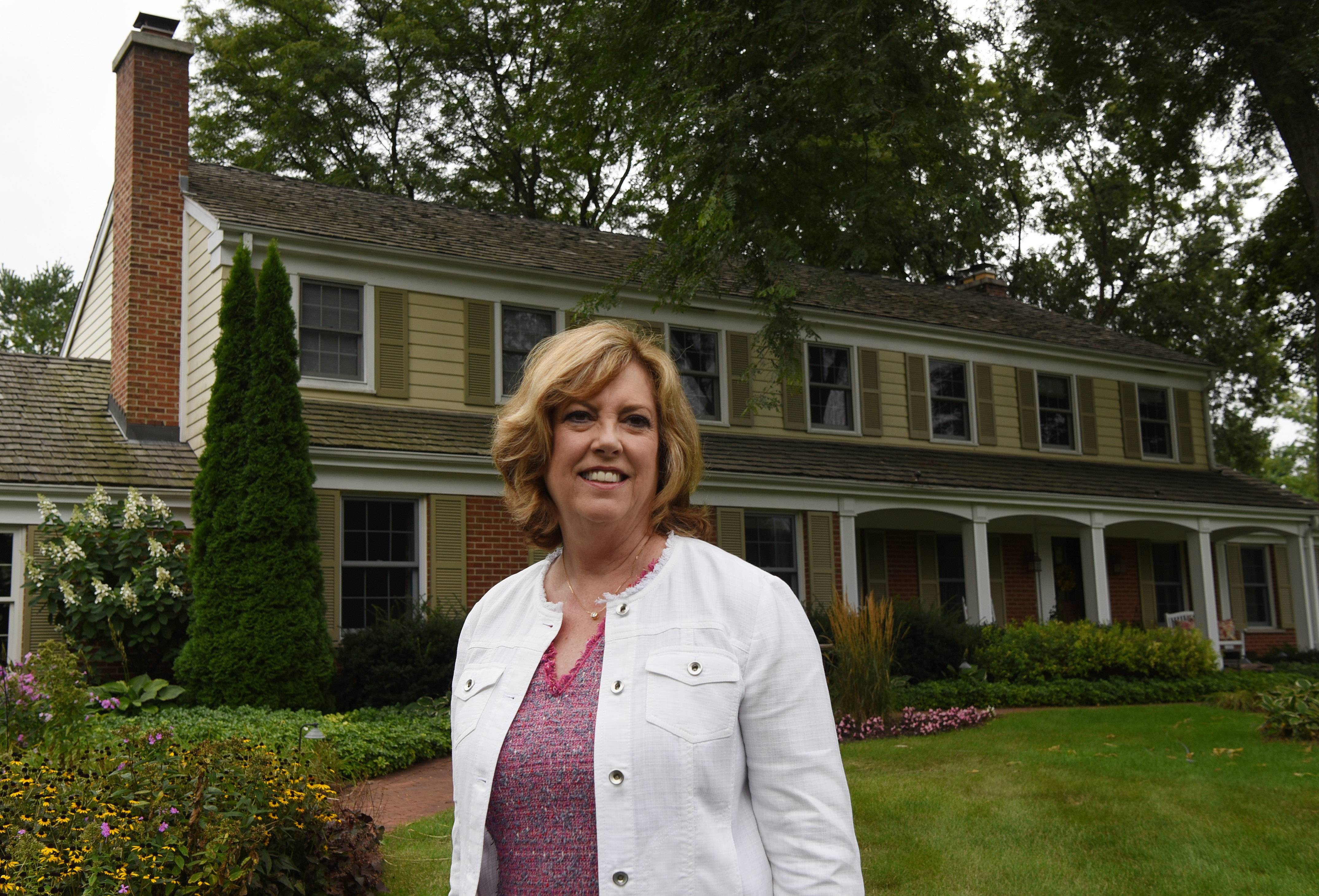 Today's buyer wants a move-in ready home, says Denise Curry of Baird & Warner, shown at one of her listings in Inverness.