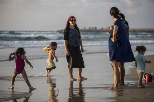 In this photo made on Thursday, Sep. 1, 2016, Israeli Jewish woman wears modest swimsuite on the beach near the port city of Ashdod, Israel. France's burkini controversy is boosting the bottom line for Israeli makers of modest swimwear. Israel, home to large populations of conservative Jewish and Muslim women, has cultivated a local industry of modest swimsuits, and the full-body outfits that have caused uproar in France have been a common sight on Israeli beaches for several years.