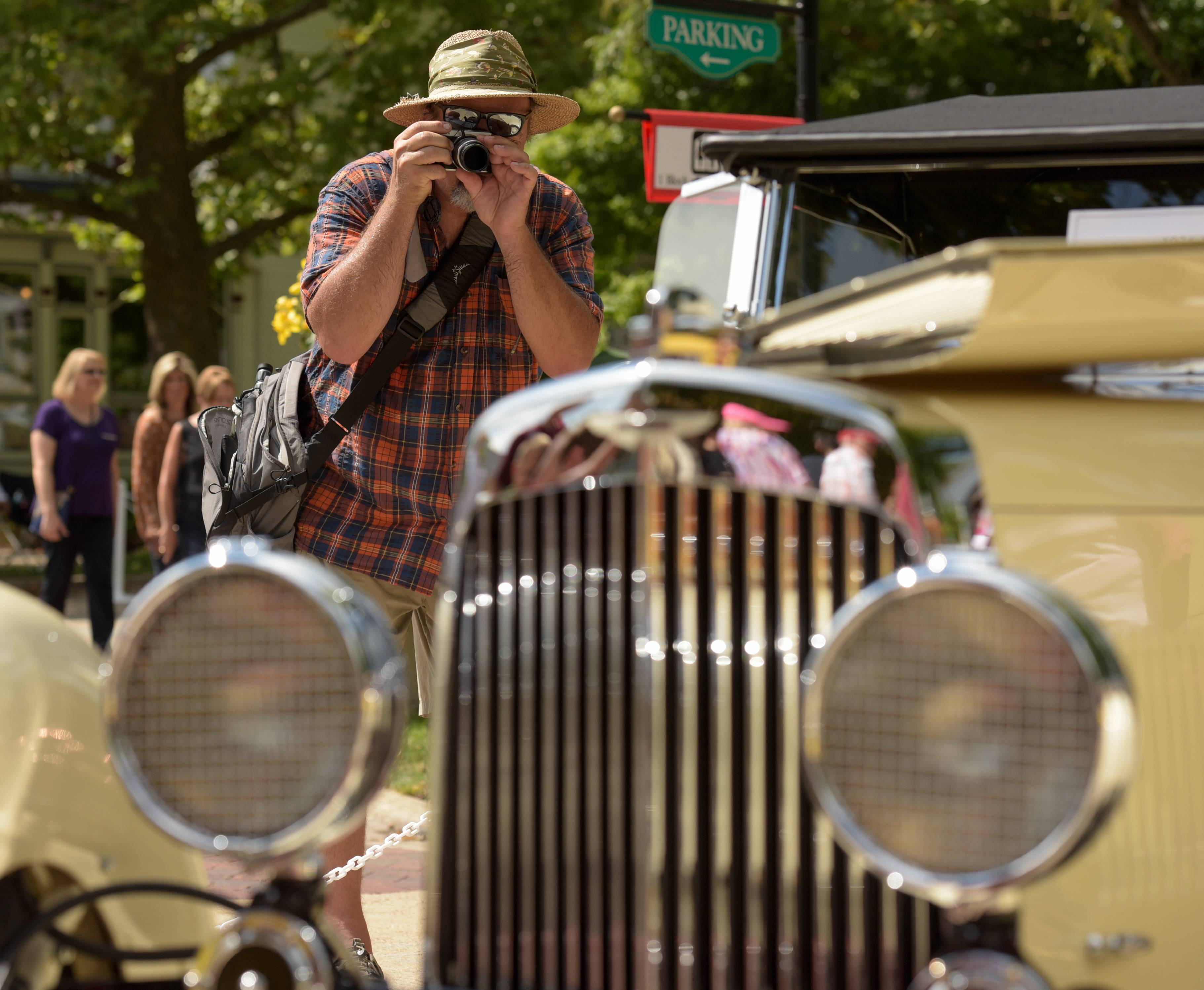 Photography enthusiast Arnie Kalnins, of Batavia photographs a 1934 Aston Martin Mark II Sunday at the annual Concours d'Elegance Car Show in downtown Geneva. Kalnins comes to the show every year.