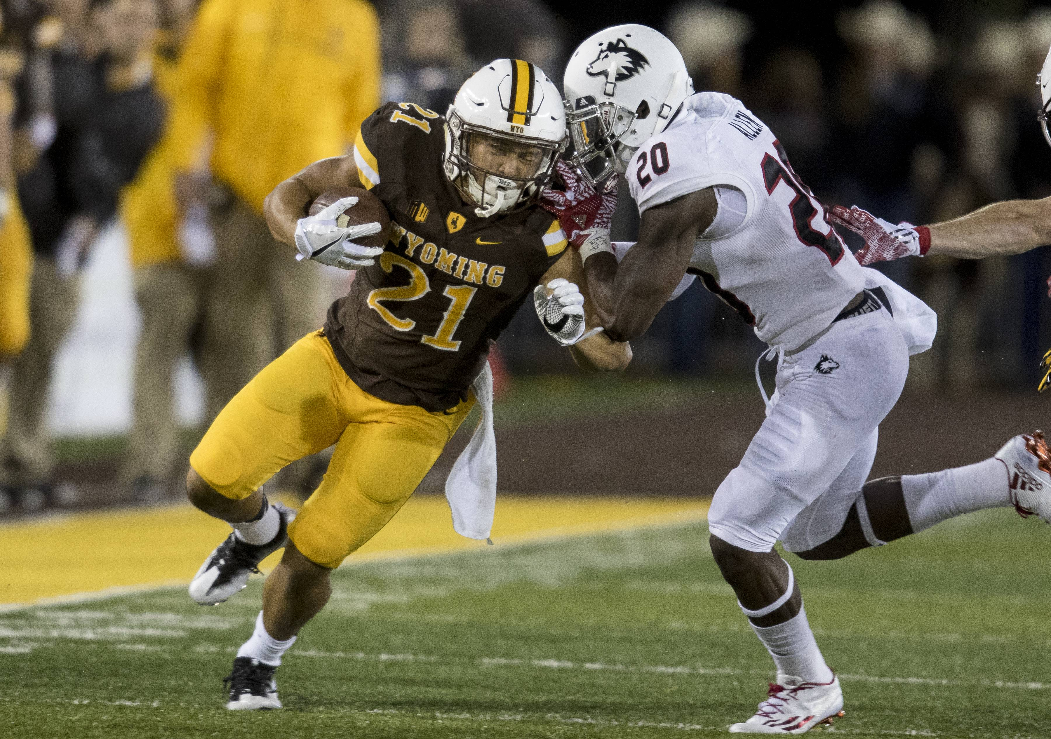 Wyoming running back Shaun Wick runs with the ball during during an NCAA college football game against Northern Illinois Saturday, Sept. 3, 2016 at the War Memorial Stadium in Laramie, Wyo.  (Hugh Carey/The Wyoming Tribune Eagle via AP)