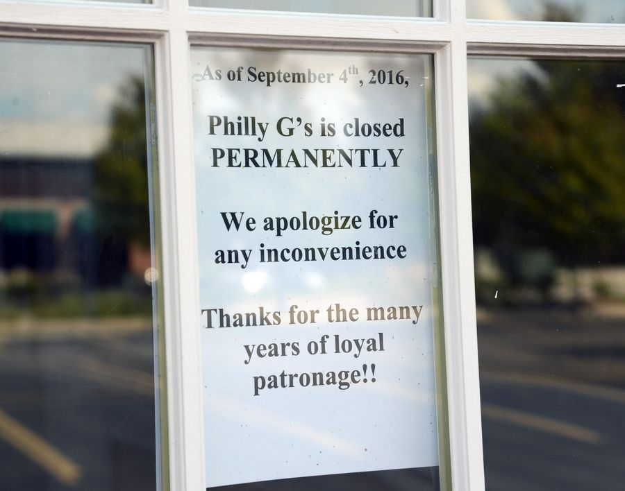 Signs posted on the entrances to Philly G's in Vernon Hills announce the restaurant's closing.