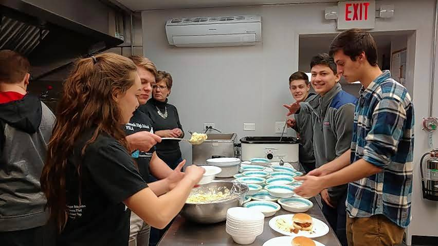 Members of Wauconda High School's Future Business Leaders of America club prepare food for the group's monthly Meals For All gathering this past January. The club on Wednesday will offer free meals to area police officers.
