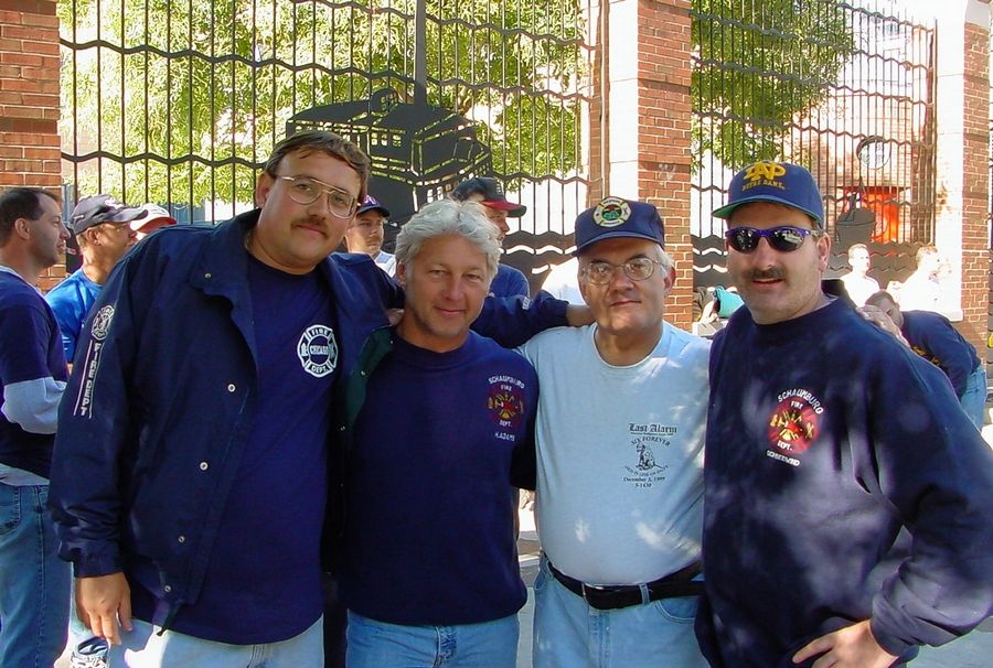 Butch Adams, second from left, and Jack Schneidwind, far right, were among the Schaumburg firefighters who traveled to New York in the wake of the attacks. Roy Hervas, left, a former volunteer photographer for the department, chronicled the trip.