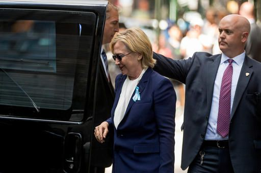 "Democratic presidential candidate Hillary Clinton gets into a van as she leaves an apartment building Sunday, Sept. 11, 2016, in New York. Clinton's campaign said the Democratic presidential nominee left the 9/11 anniversary ceremony in New York early after feeling ""overheated."""
