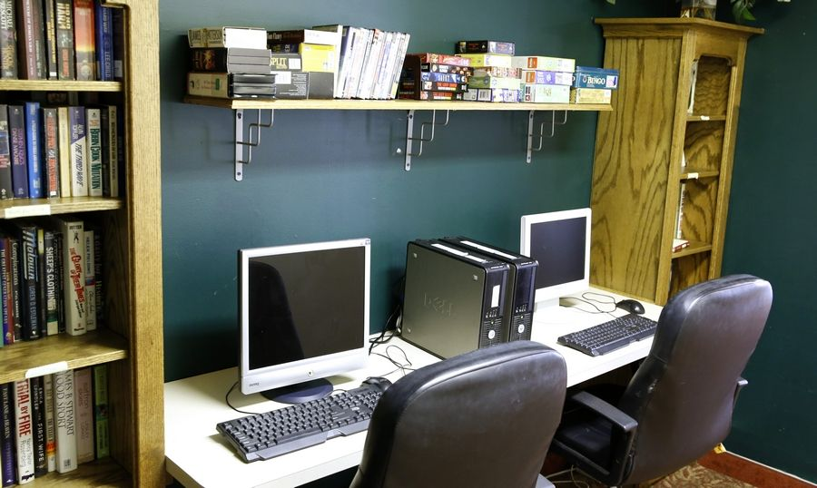Computers and books are included in a study area offered by Naperville Elderly Homes at Martin Avenue Apartments.