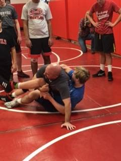 Athletic director Dan Jones participates in a Hinsdale Central wrestling practice.
