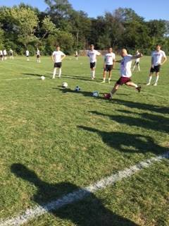 Athletic director Dan Jones participates in a Hinsdale Central soccer practice.
