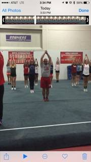 Athletic director Dan Jones participates in a Hinsdale Central cheerleading practice.