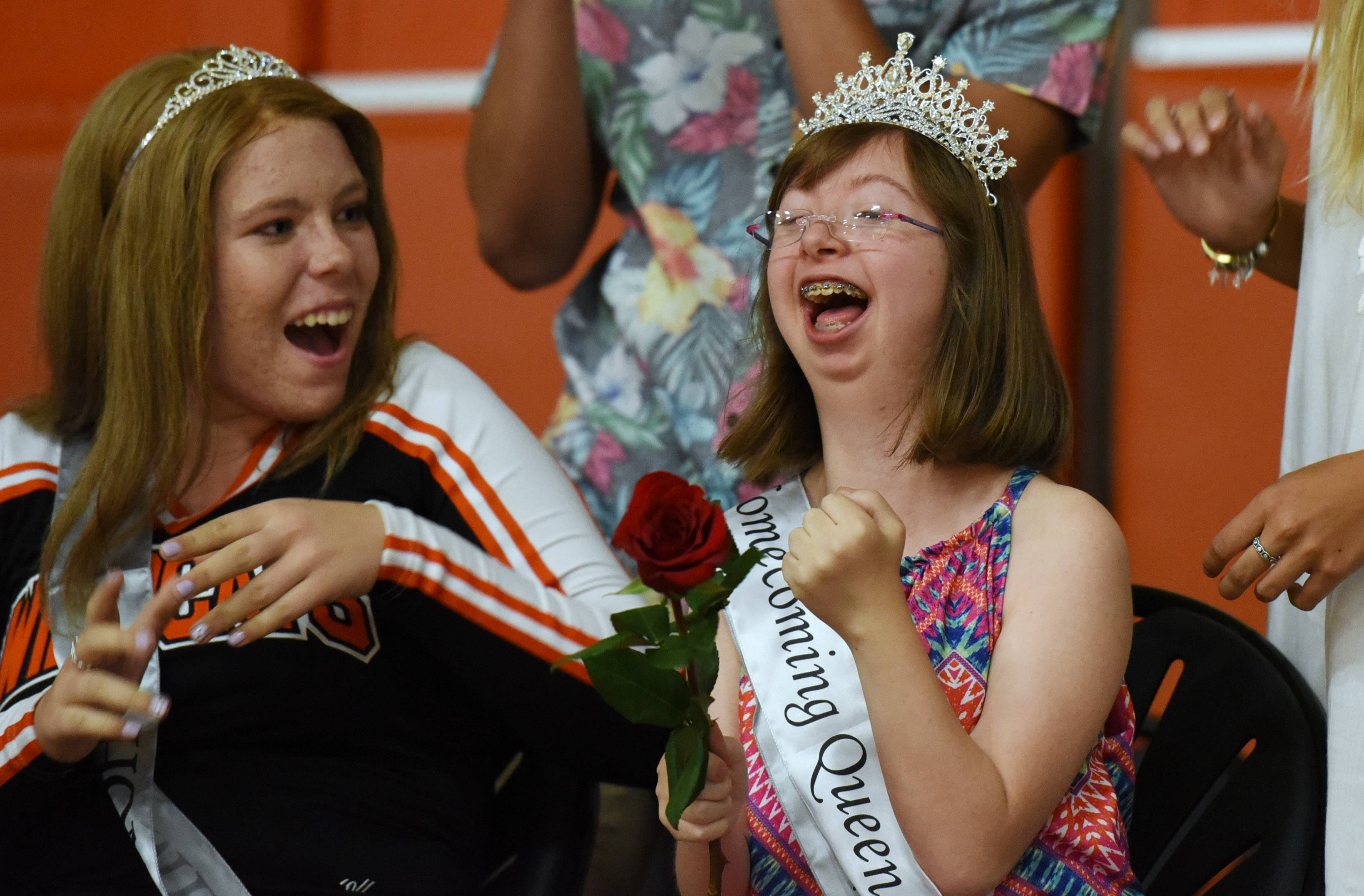 Libertyville High School student Hope Michelotti, right, 18, reacts after being crowned the 2016 homecoming queen Friday as Ashley Junkunc looks on. Students voted live from their phones for their queen during an assembly.