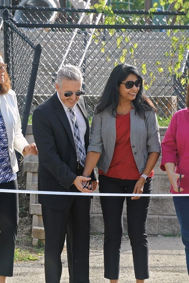 Superintendent of Schools John Hutton, left, and Gurnee Park District Executive Director Susie Kuruvilla cut the ribbon on the new playground at River Trail School.