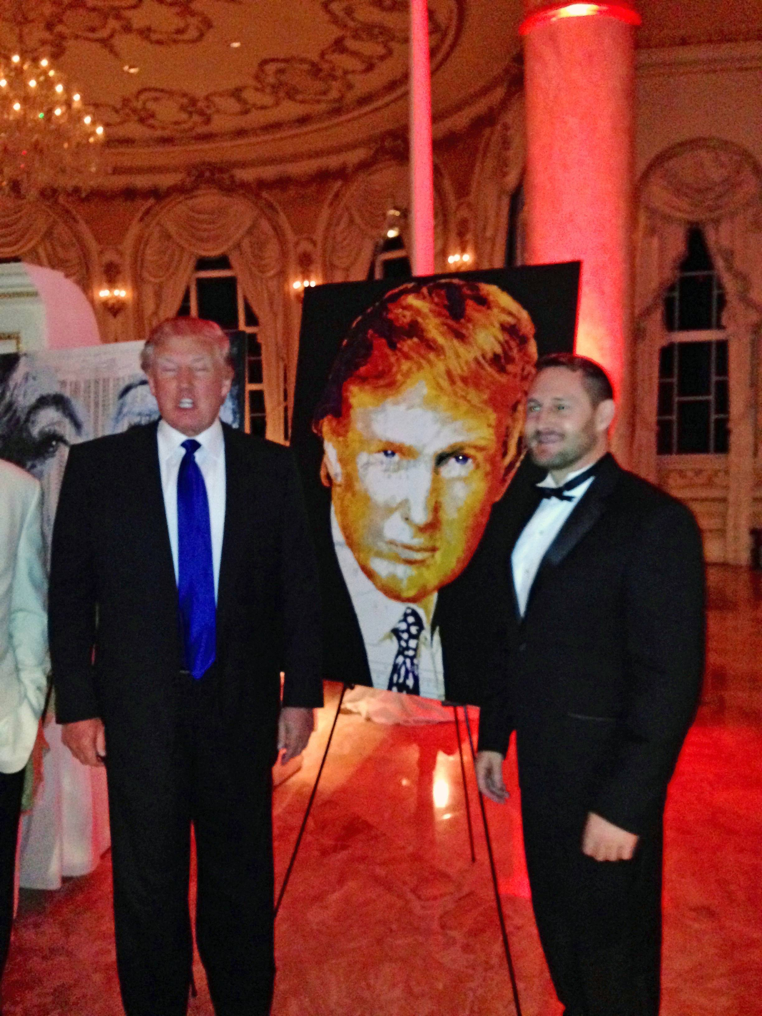 Trump with the painting that he bought.