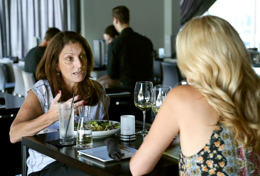Jeanne Giovenco, left, of Deer Park and Kim Sellars of Barrington chat over their meals at Neoteca Pizza and Wine Bar in Barrington.