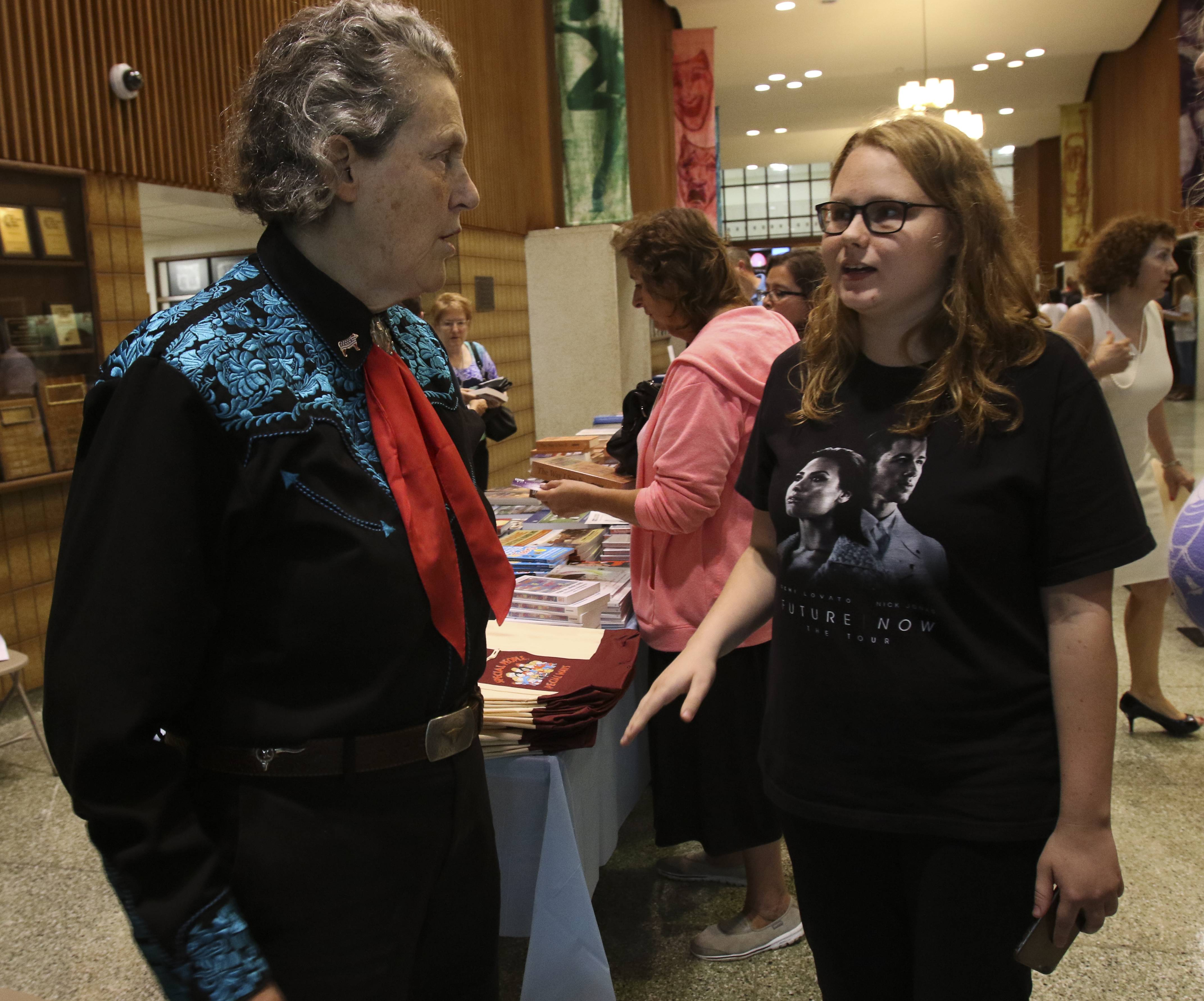 Bridget Van Pettten, a senior at Glenbard East, right, meets Temple Grandin before her talk on the autistic mind as part of the Glenbard Parent Series Wednesday afternoon. Bridget has autism and considers Grandin an inspiration.