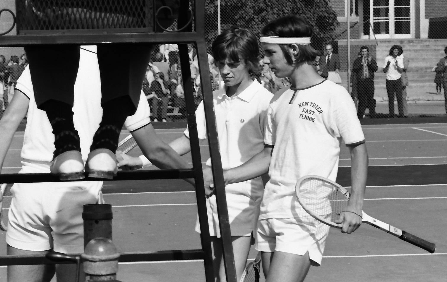New Trier East doubles tennis team shakes hands with their opponents as the high school state tennis tournament at Arlington High School in May of 1972.