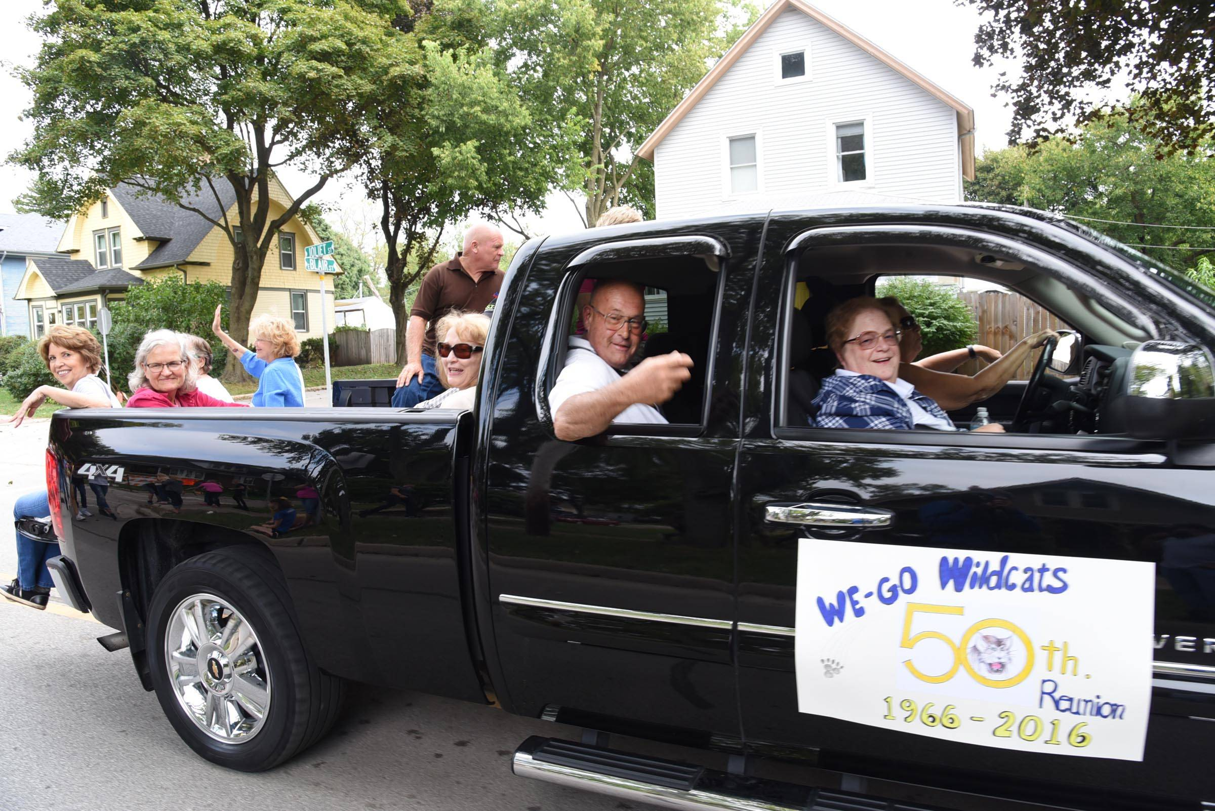 Alumni from the Class of 1966 ride in the West Chicago Community High School homecoming parade Friday afternoon.
